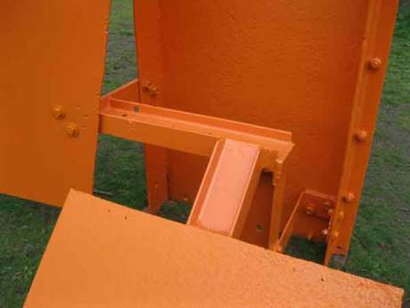 This is a close up of a sculpture by Sir Anthony Caro, a strong metal structure,