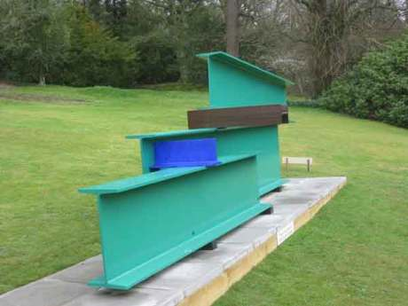 long bar sculpture by Sir Anthony Caro, steel girders placed on on top of another,