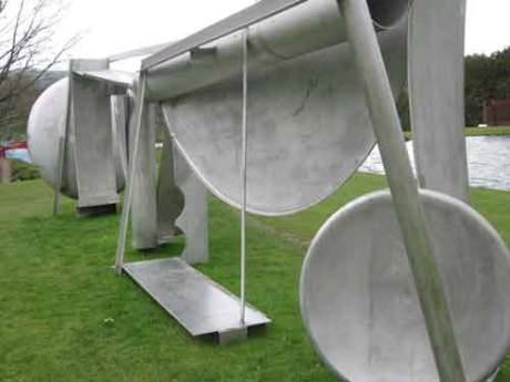 Anthony Caro has made an emotional piece of sculpture, a silver coloured piece of sculpture called Double Tent,