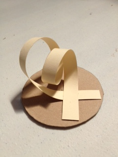 Sculpture by Gregory, double loop and cross is number 4 in the revolve series